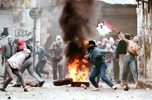 (FILES) Palestinians demonstrators throw rocks, 29 January 1988 in Nablus, at Israeli soldiers during violent protests gainst the Israeli occupation. The Palestinian uprising,